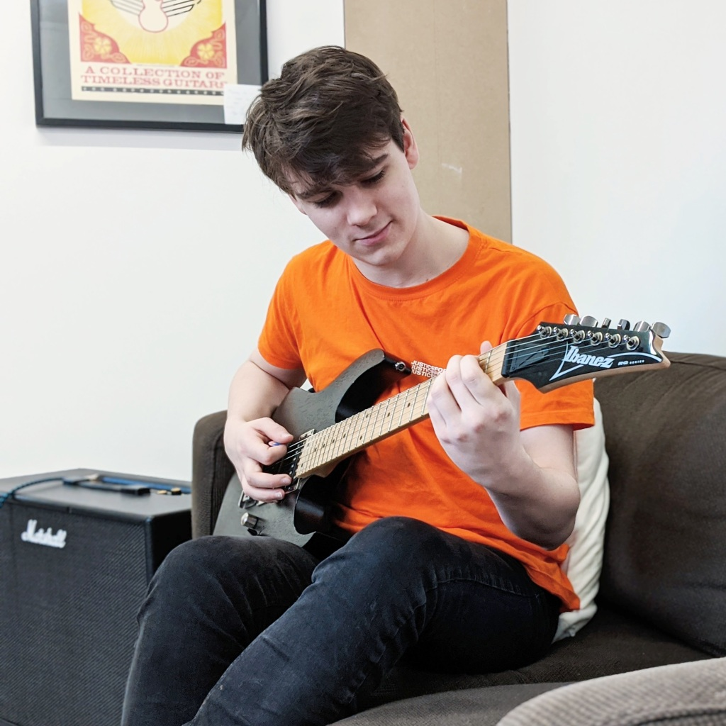 A student having his guitar lesson at The JTSCM.